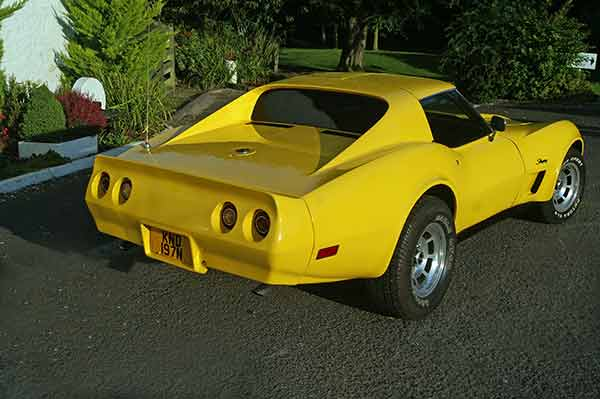 Our bright yellow Corvette C3 from our muscle car hire fleet